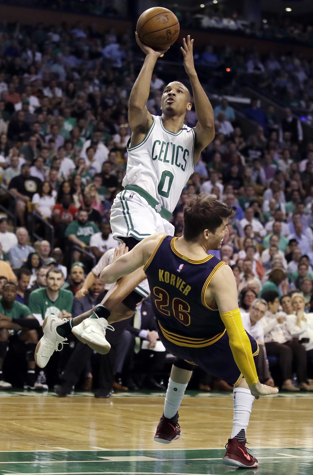 Boston Celtics guard Avery Bradley drives against Cleveland Cavaliers guard Kyle Korver (26) during the first quarter of Game 1 of the ...