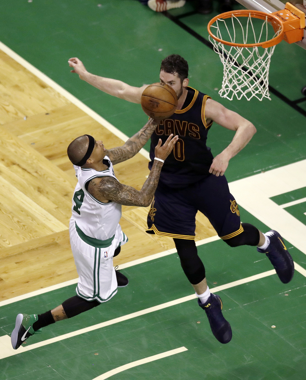 Boston Celtics guard Isaiah Thomas, left, drives to the basket against Cleveland Cavaliers forward Kevin Love during the second quarter...