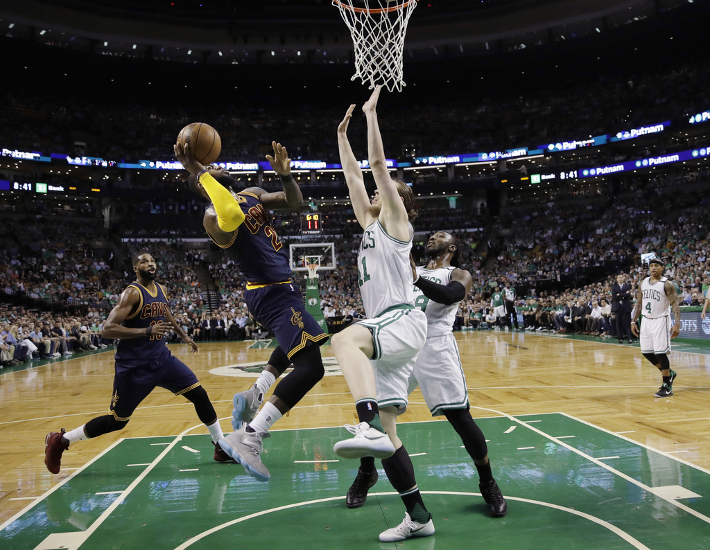 Cleveland Cavaliers forward LeBron James shoots against Boston Celtics center Kelly Olynyk (41) during the first quarter of Game 1 of t...