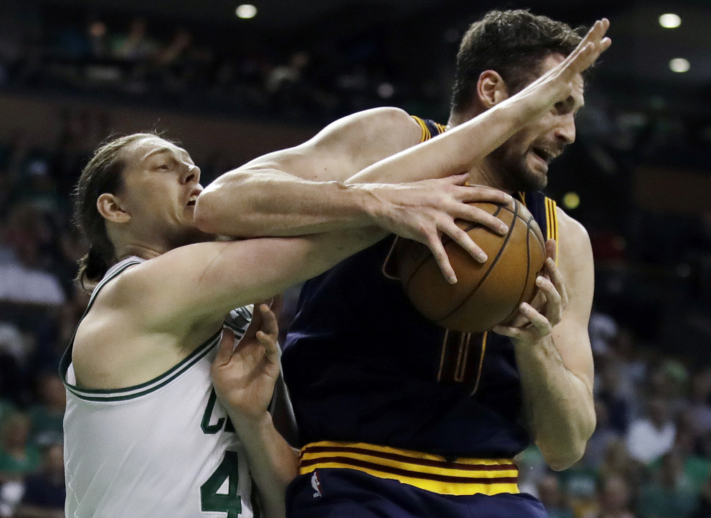 Boston Celtics center Kelly Olynyk, left, and Cleveland Cavaliers forward Kevin Love vie for a rebound during the first quarter of Game...