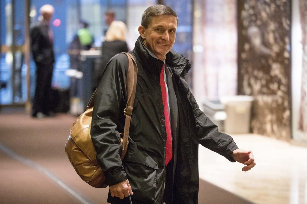 FILE - In this Jan. 3, 2017, file photo, Michael Flynn, then - President-elect Donald Trump's nominee for National Security Adviser arr...