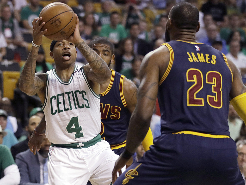 Boston Celtics guard Isaiah Thomas (4) prepares to shoot as Cleveland Cavaliers forward LeBron James (23) defends during the first quar...