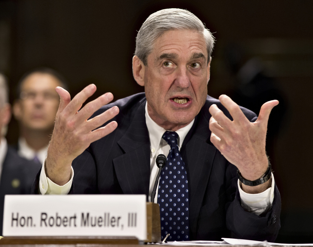 FILE - In this June 19, 2013, file photo, former FBI Director Robert Mueller testifies on Capitol Hill in Washington. On May 17, 2017, ...
