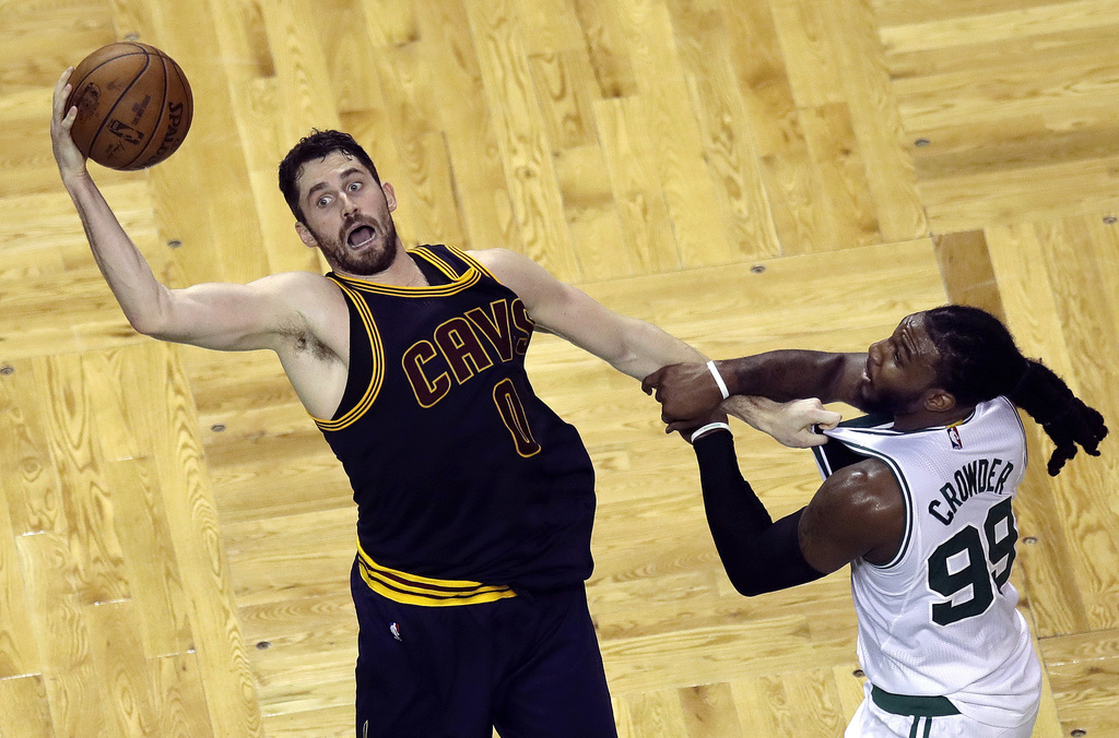 Cleveland Cavaliers forward Kevin Love, left, and Boston Celtics forward Jae Crowder grab hold of each other during the second quarter ...