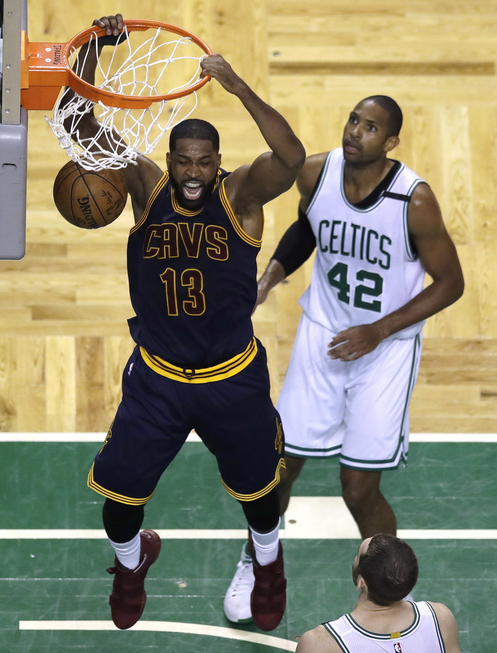 Cleveland Cavaliers center Tristan Thompson follows through on a dunk in front of Boston Celtics center Al Horford (42) during the seco...