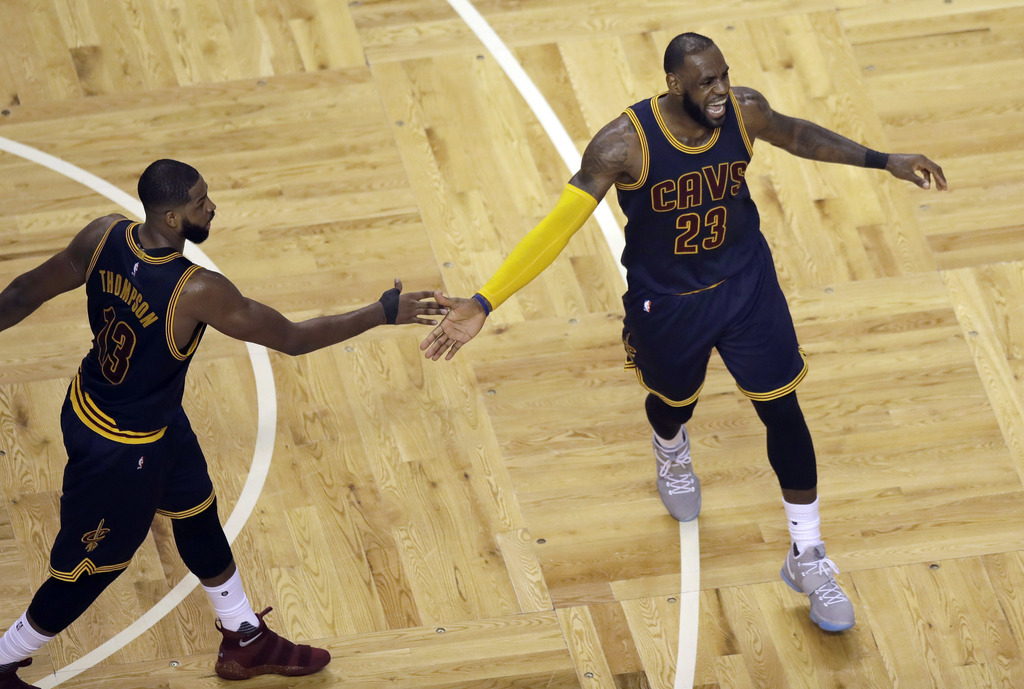 Cleveland Cavaliers center Tristan Thompson, celebrates with forward LeBron James after a basket during the second quarter of Game 1 of...