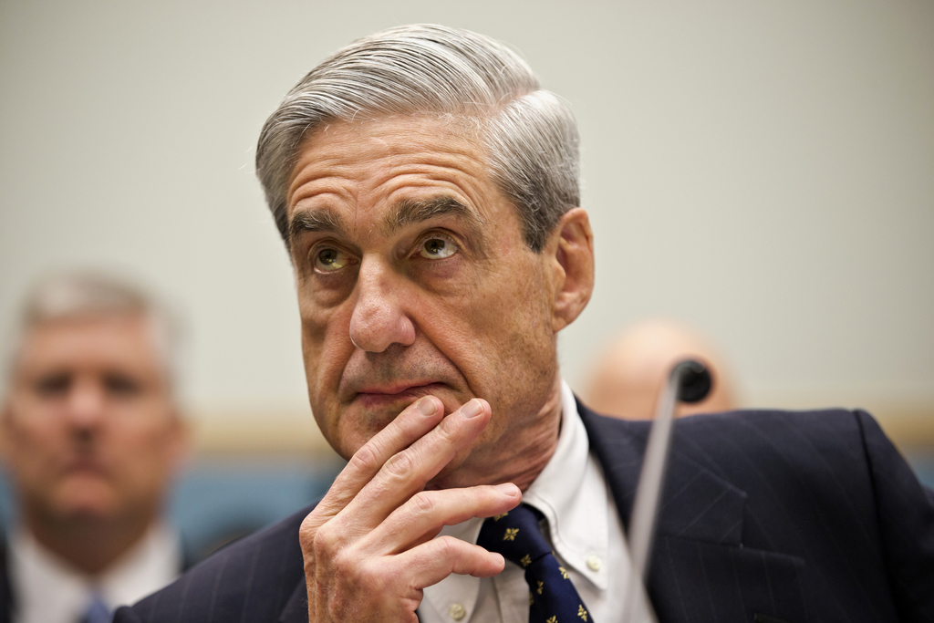FILE - In this June 13, 2012, file photo then-FBI Director Robert Mueller listens as he testifies on Capitol Hill in Washington. Muelle...