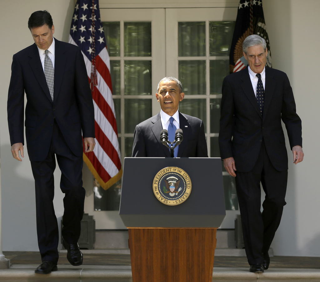 FILE - In this June 21, 2013, file photo, President Barack Obama, followed by outgoing FBI Director Robert Mueller, right, and his choi...