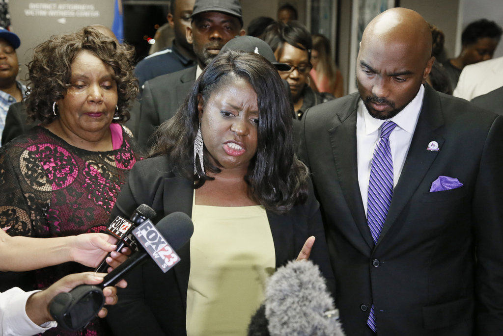 Tiffany Crutcher, center, sister of Terence Crutcher, talks with the media following a verdict in the trial of Tulsa police officer Bet...