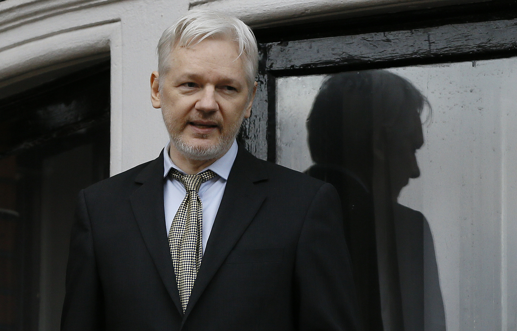FILE - In this Feb. 5, 2016 file photo, WikiLeaks founder Julian Assange speaks from the balcony of the Ecuadorean Embassy in London. S...