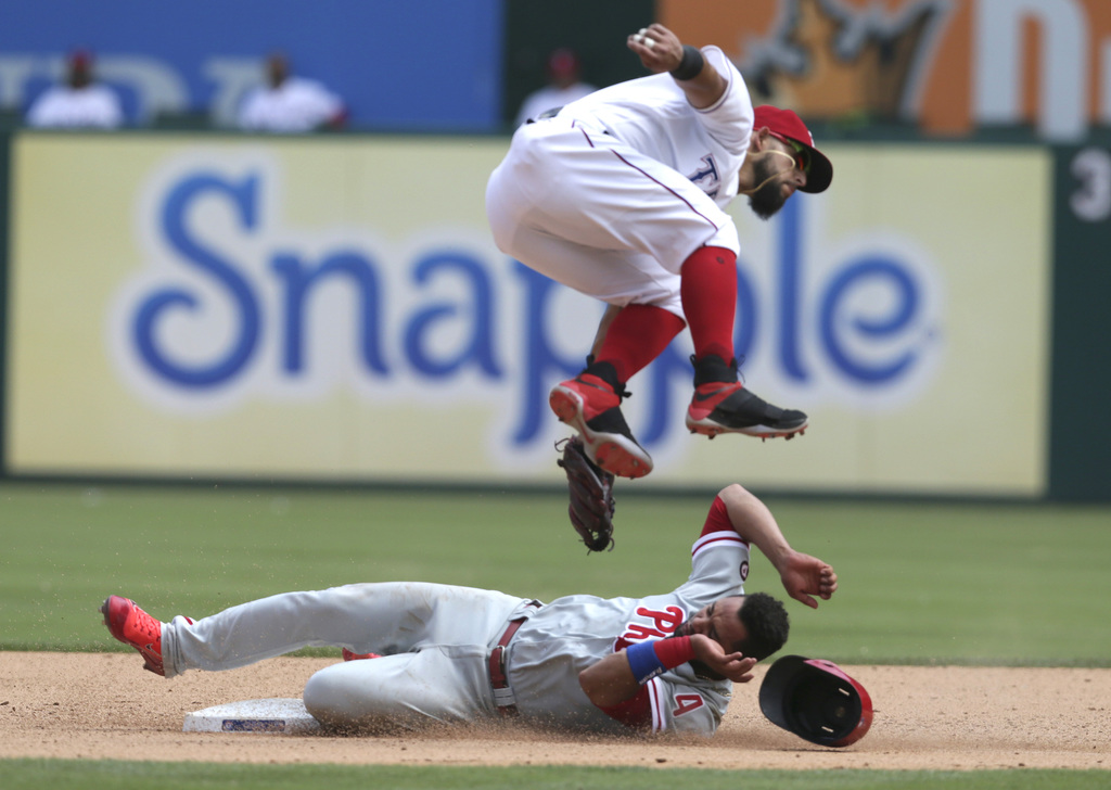 Philadelphia Phillies' Andres Blanco, bottom, steals second base against Texas Rangers second baseman Rougned Odor during the seventh i