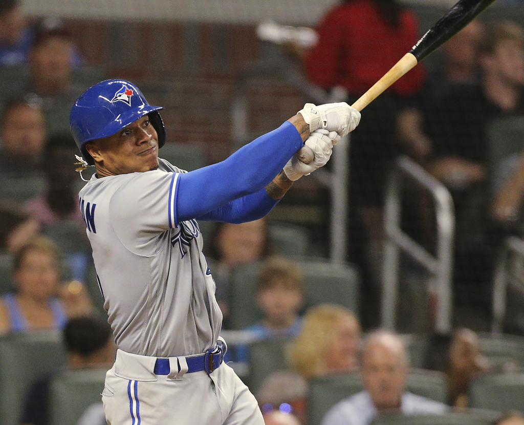 Toronto Blue Jays pitcher Marcus Stroman follows through on a home run during the fourth inning against the Atlanta Braves in a basebal