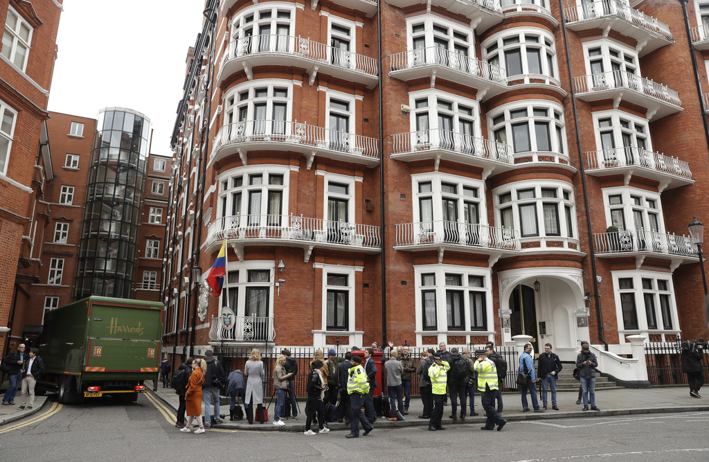 People gather outside of the Ecuadorian embassy in London, Friday May 19, 2017. Sweden's top prosecutor says she is dropping an investi...