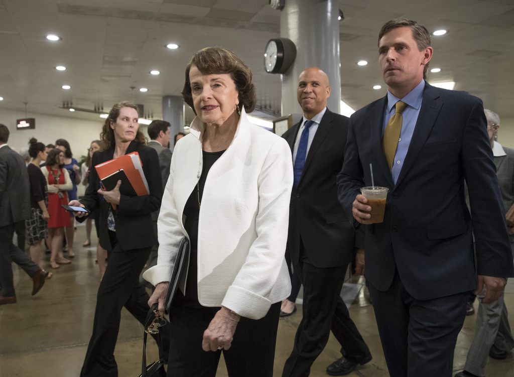 From left, Sen. Dianne Feinstein, D-Calif., ranking member on the Senate Judiciary Committee, Sen. Cory A. Booker, D-N.J., and Sen. Mar...
