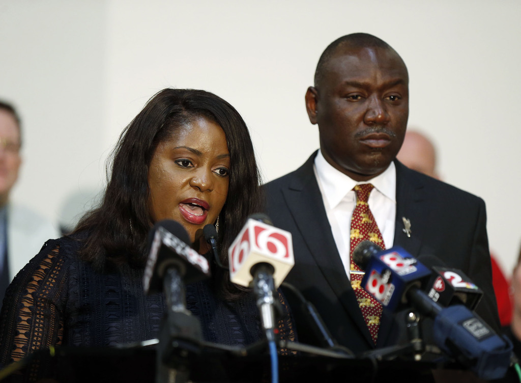 Tiffany Crutcher, sister of Terence Crutcher, and Benjamin Crump speak during a press conference in Tulsa, Okla., Thursday, May 18, 201...