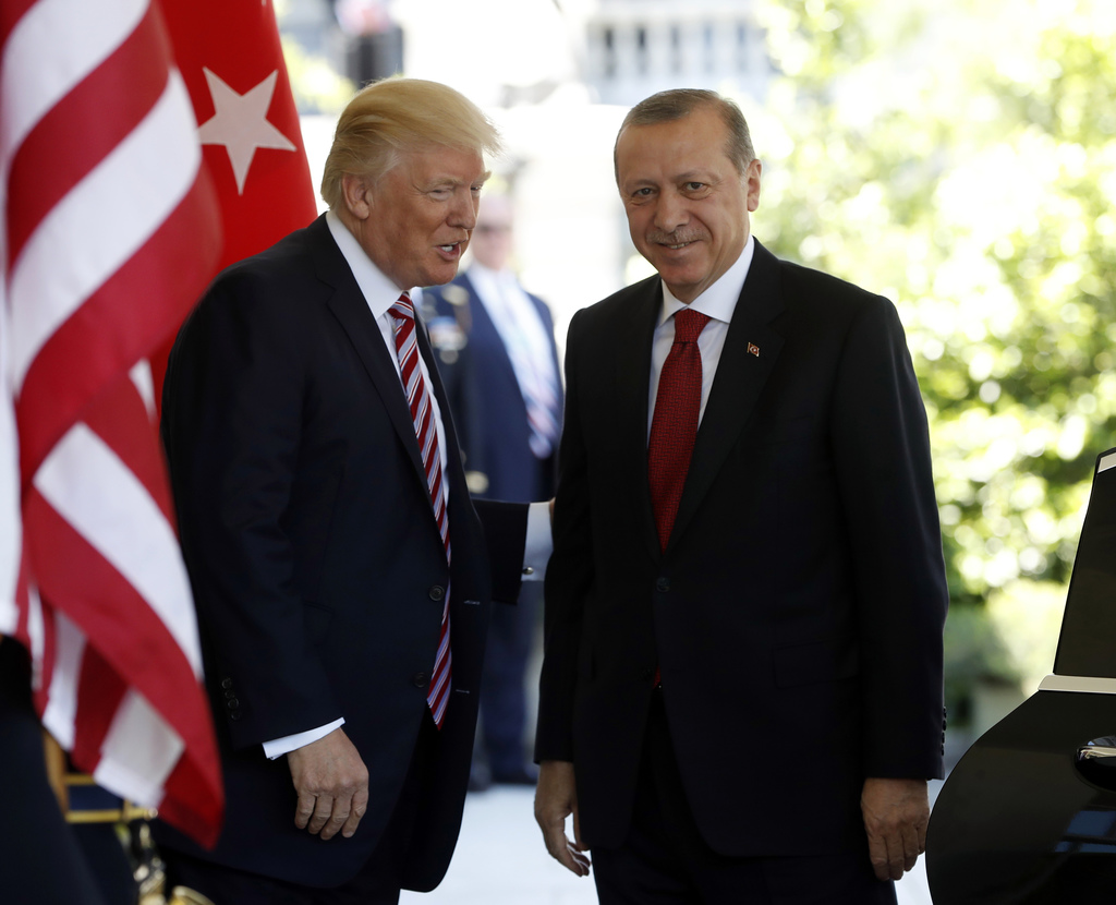 In this May 16, 2017, photo, President Donald Trump welcomes Turkish President Recep Tayyip Erdogan to the White House in Washington. T...