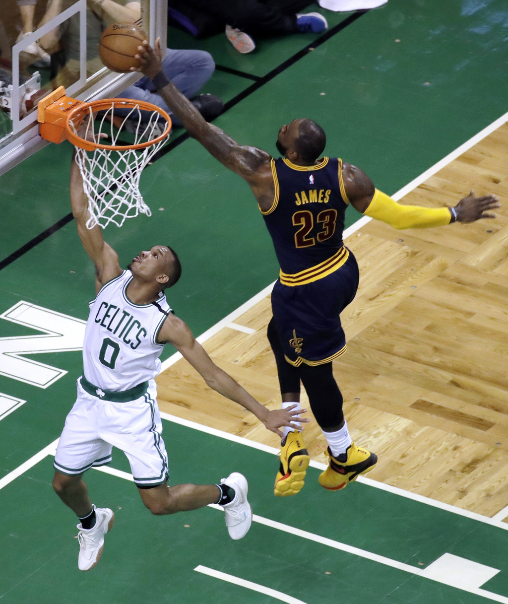 Cleveland Cavaliers forward LeBron James, right, blocks a shot by Boston Celtics guard Avery Bradley during the first half of Game 2 of...