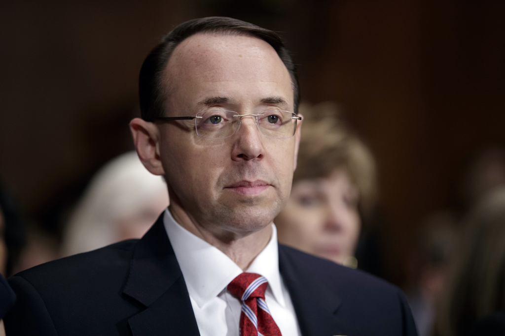 FILE- In this March 7, 2017, file photo, then-Deputy Attorney General-designate Rod Rosenstein, listens on Capitol Hill in Washington, ...