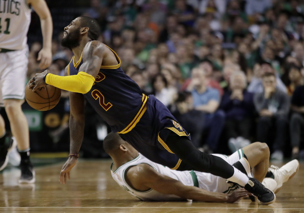 Cleveland Cavaliers guard Kyrie Irving (2) falls with Boston Celtics guard Avery Bradley (0) during the first half of Game 2 of the NBA...