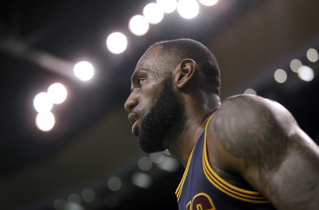 Cleveland Cavaliers forward LeBron James walks upcourt during first half of Game 2 of the NBA basketball Eastern Conference finals agai...