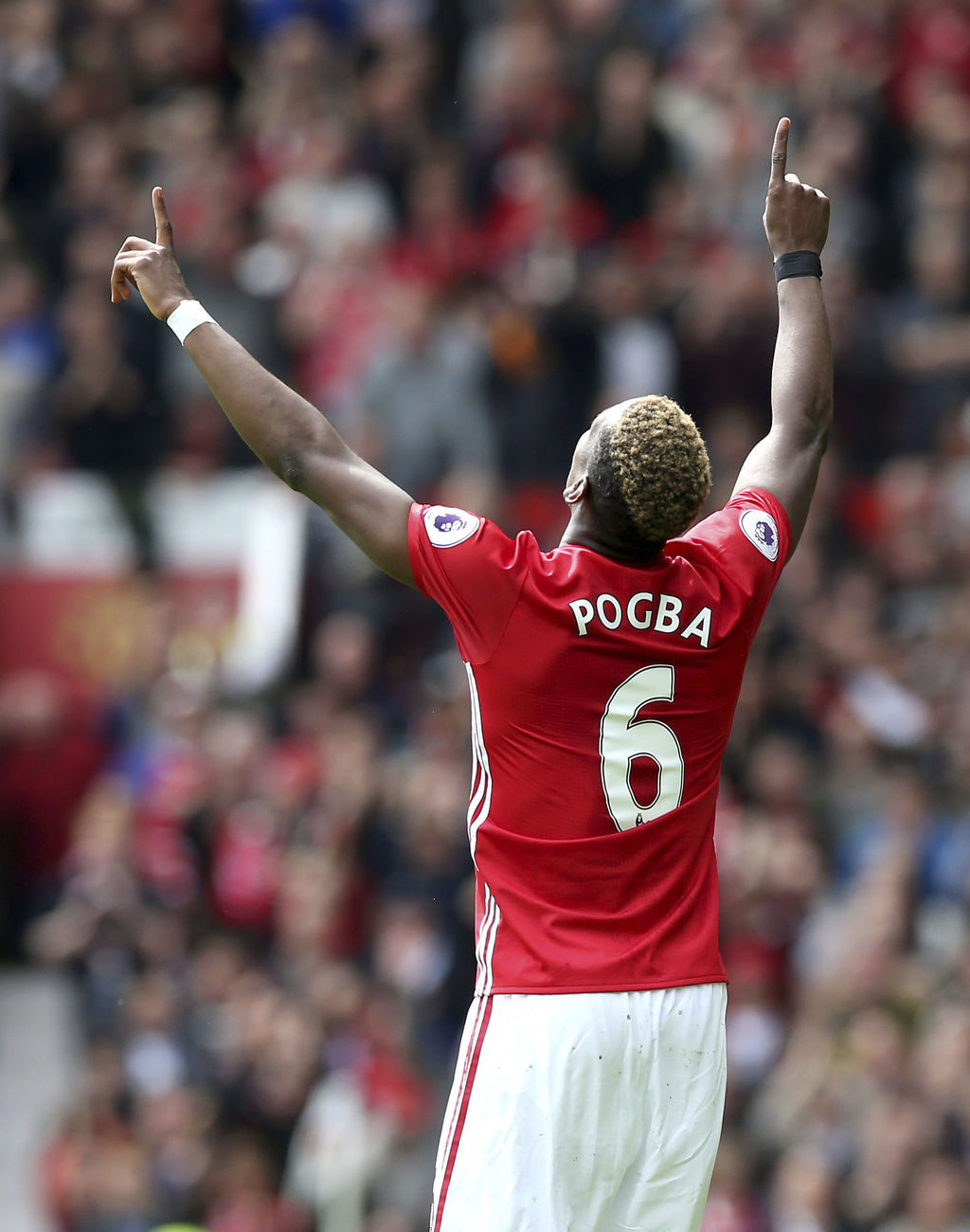 Manchester United's Paul Pogba celebrates scoring his team's second goal of the game, during the English Premier League soccer match be...