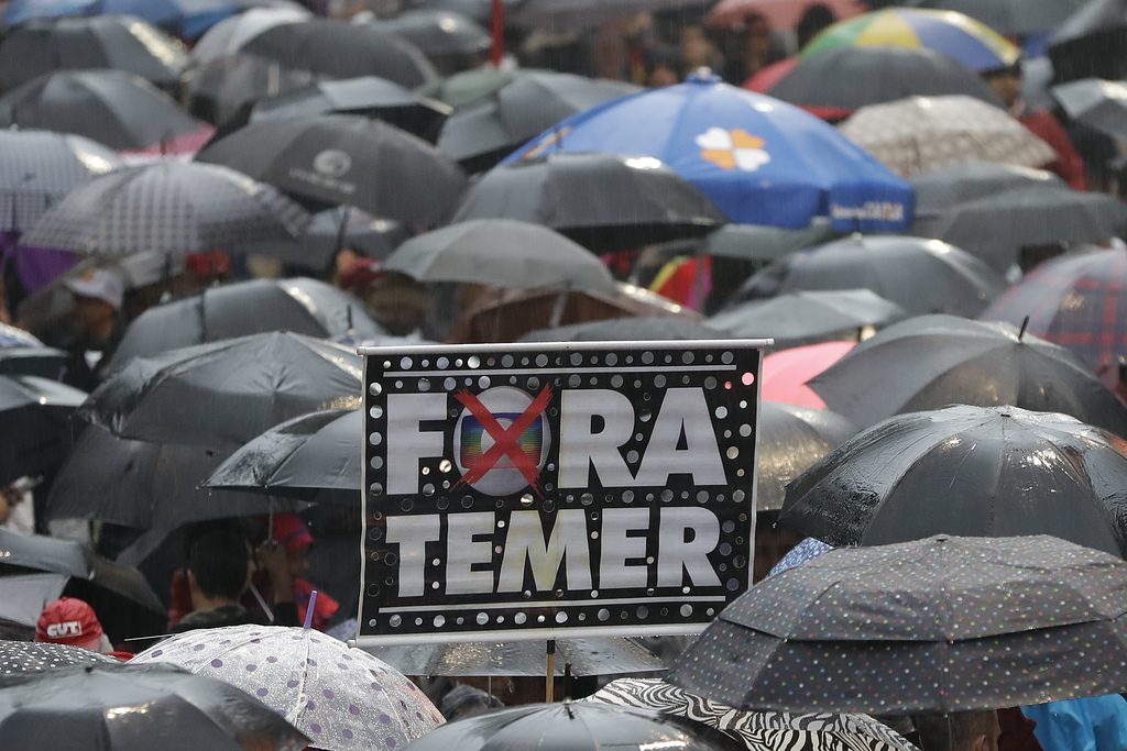 """Demonstrators march against Brazil's President Michel Temer, holding banners that reads in Portuguese """"Temer Out"""", in Sao Paulo, Brazil..."""