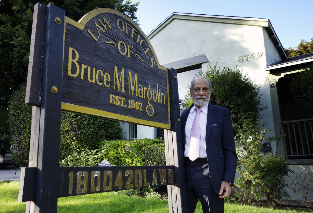 In this Jan. 19, 2917 photo, attorney Bruce Margolin stands by a sign outside his office in West Hollywood, Calif. Marlin, has crusaded...