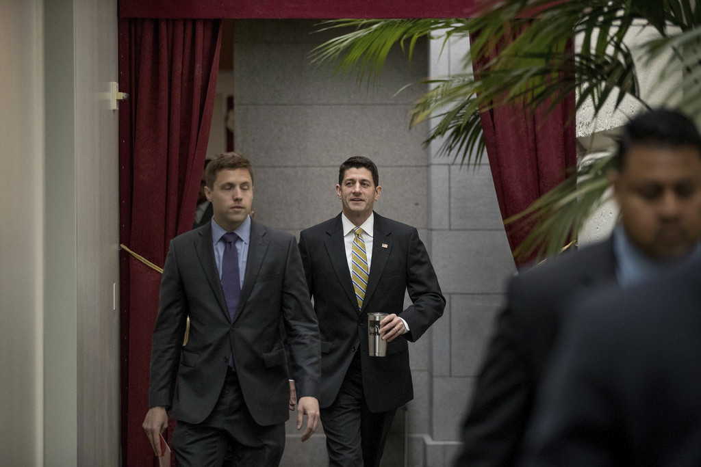 House Speaker Paul Ryan of Wis., center, arrives for a GOP caucus meeting on Capitol Hill in Washington, Tuesday, May 23, 2017. (AP Pho...