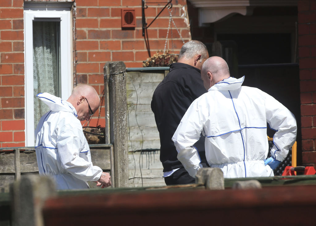 Police forensic investigators search the property of Salmon Abedi in connection with the explosion that took place at the Manchester Ar...