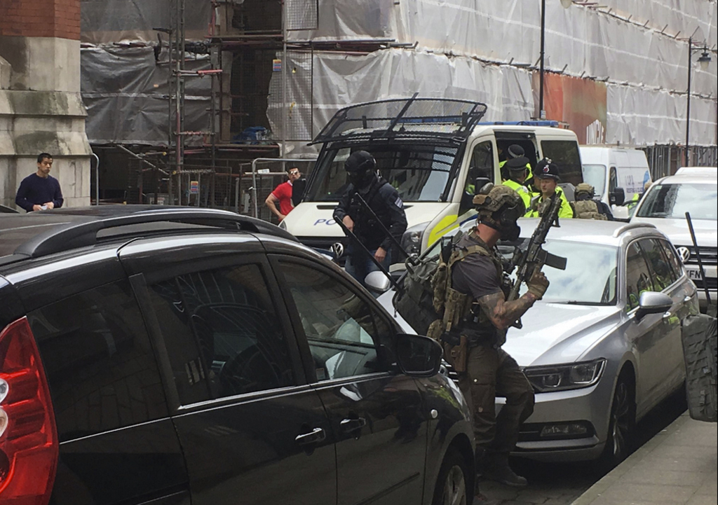 Police from the Tactical Aid Unit  prepre to enter Granby House apartments in Manchester England, Wednesday May 24, 2017  in connection...