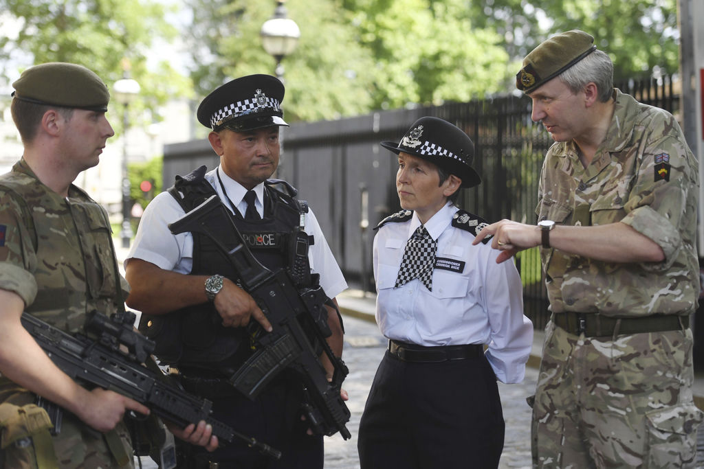Metropolitan Police Commissioner Cressida Dick, 2nd right, and Major General Ben Bathhurst, General Officer Commanding London District,...