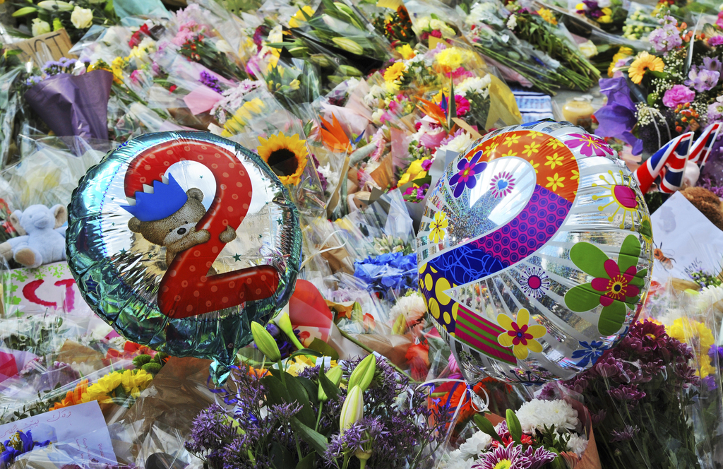 Floral tributes on display for the victims of the concert blast, at St Ann's Square in central Manchester, England, Wednesday, May 24, ...