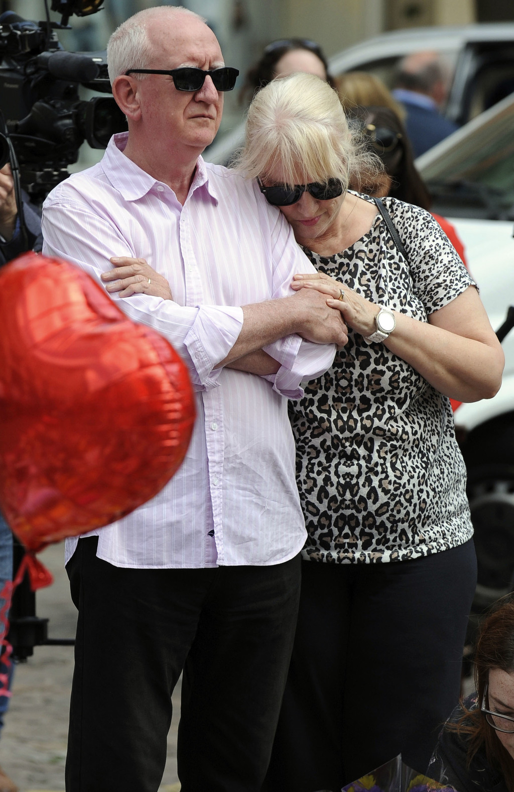People gather for a vigil  for the victims of the concert blast, at St Ann's Square in central Manchester, England, Wednesday, May 24, ...