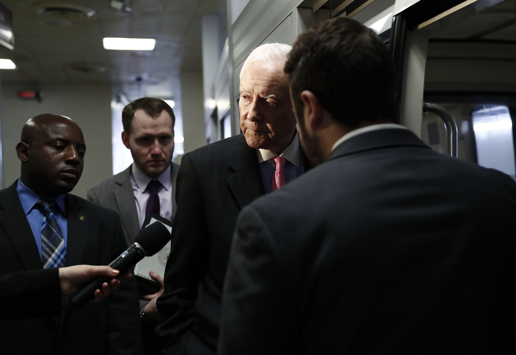 Sen. Orrin Hatch, R-Utah talk to a reporter as he steps onto the Capitol Subway on Capitol Hill in Washington, Wednesday, May 24, 2017....