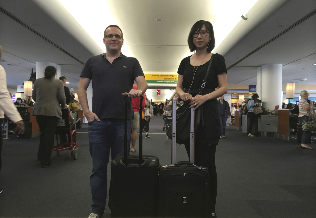 In this Friday, May 12, 2017, photo, Associated Press journalists Scott Mayerowitz and Candice Choi pose at New York's LaGuardia Airpor...