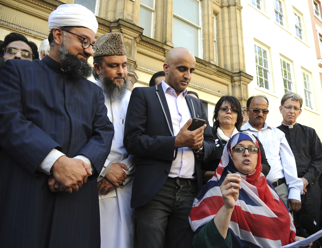Religious leaders speak to crowds during a vigil at St Ann's square in central Manchester, England Wednesday May 24 2017. Police confir...