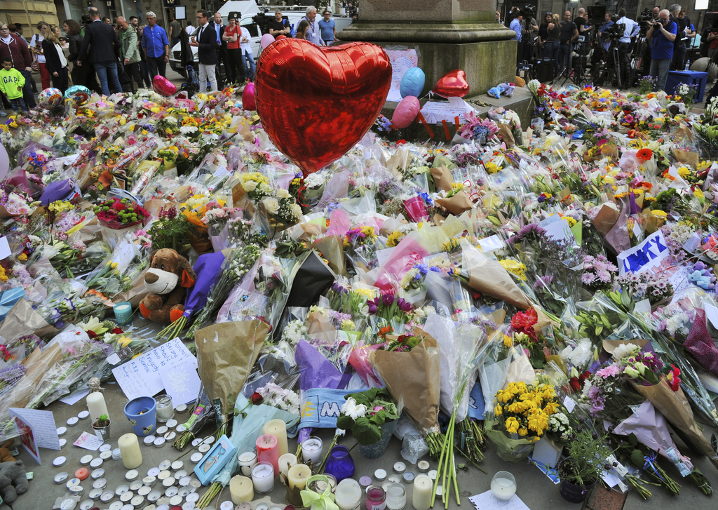 Floral tributes and messages on display for the victims of the concert blast, at St Ann's Square in central Manchester, England, Wednes...