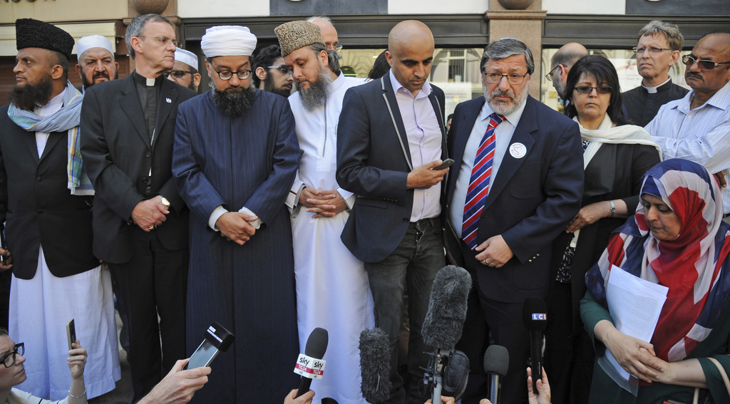 Religious leaders address crowds during a vigil at St Ann's square in central Manchester, England, Wednesday May 24 2017.  British sec...