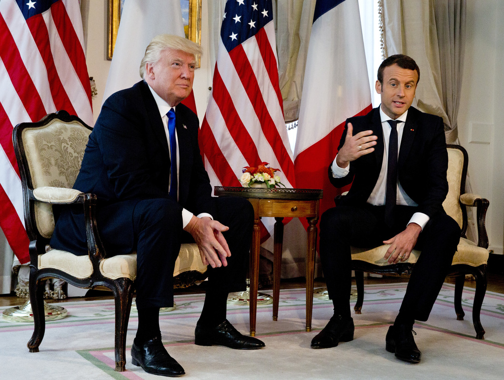 Trump handshake showdown frances macron just wont let go taiwan french president emmanuel macron gestures as he meets with us president donald trump at the us ambassadors residence in brussels kristyandbryce Choice Image