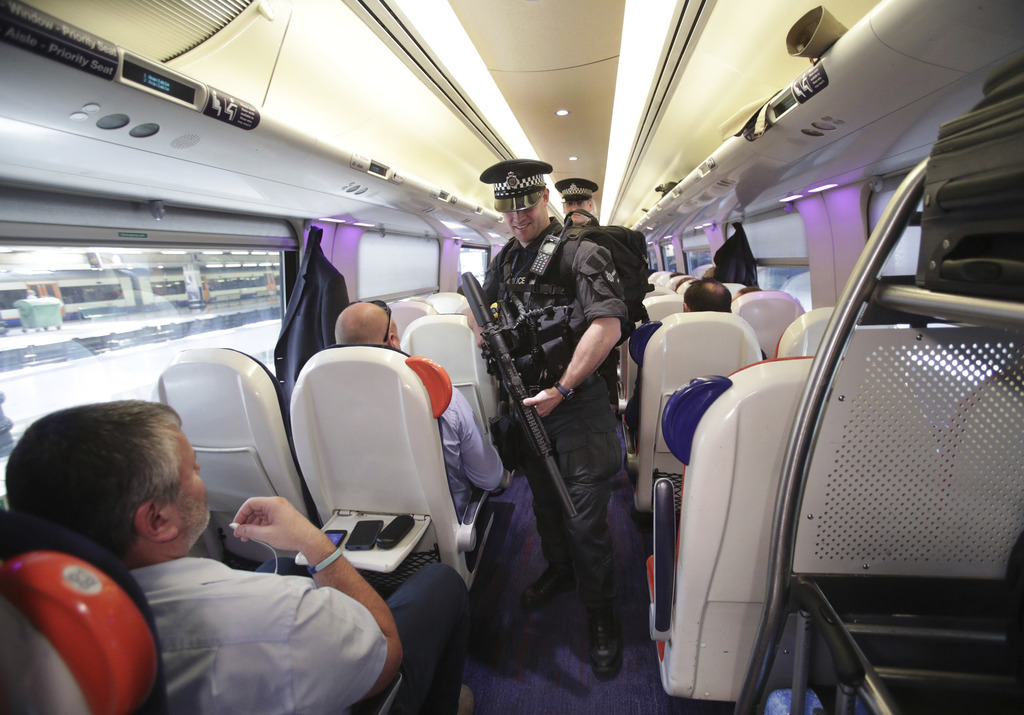 Armed British Transport Police Specialist Operations officers on board a  train to Birmingham New Street at Euston station in London as...