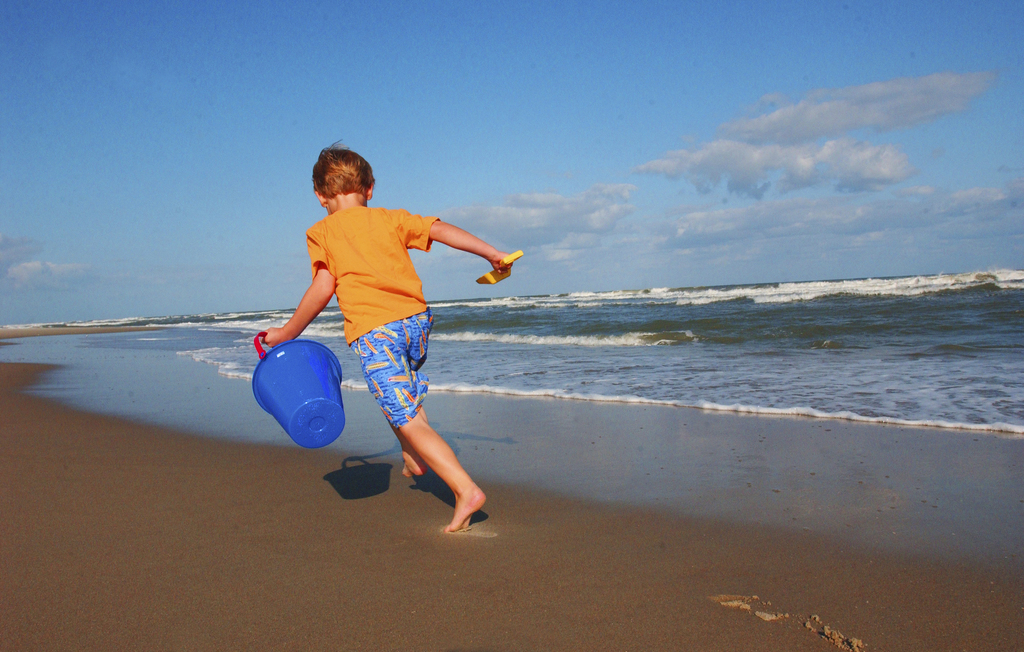 This undated photo provided by VisitNC.com shows a boy on the beach at Ocracoke on the Outer Banks of North Carolina. The Ocracoke Life...