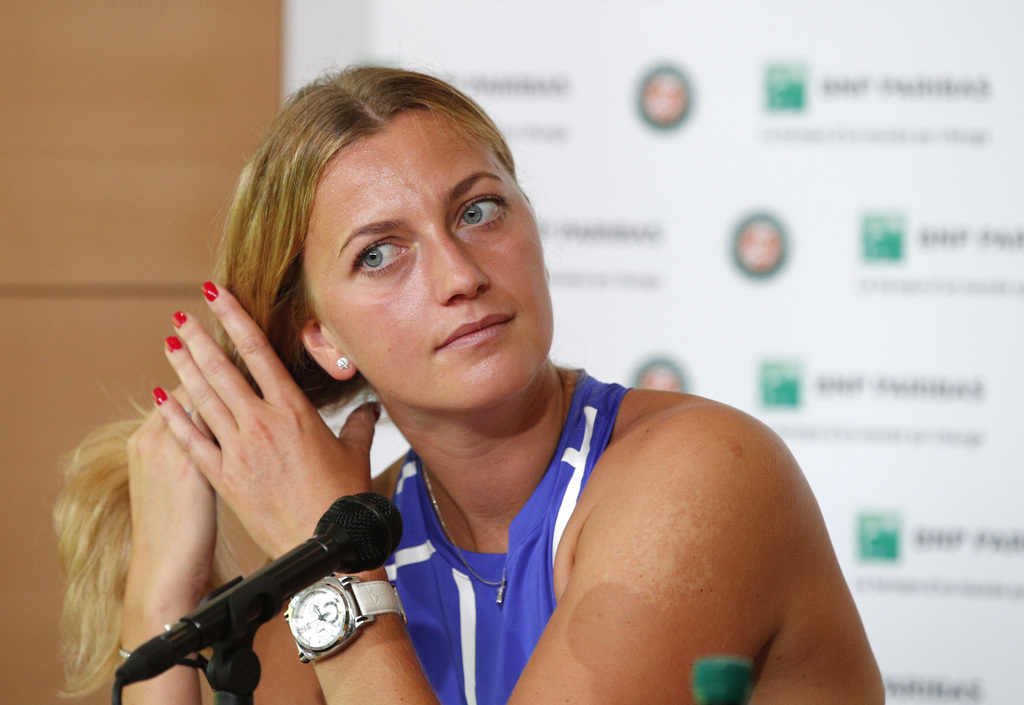 Kerber in historic loss at French Open, tearful Kvitova returns