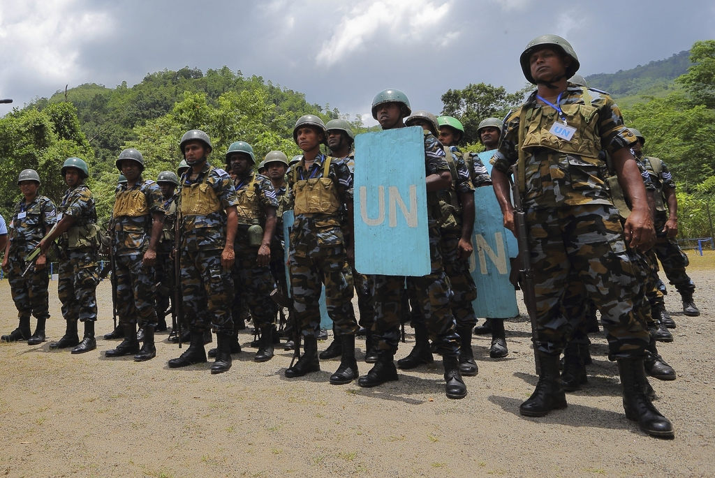 In this Sept. 13, 2016 photo, Sri Lanka Air Force airmen train for deployment as U.N. peacekeepers at the Institute of Peace Support Op...