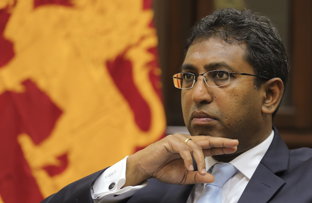 In this Sept. 14, 2016 photo, Sri Lankan Deputy Foreign Minister Harsha de Silva listens to a question during an interview in Colombo, ...