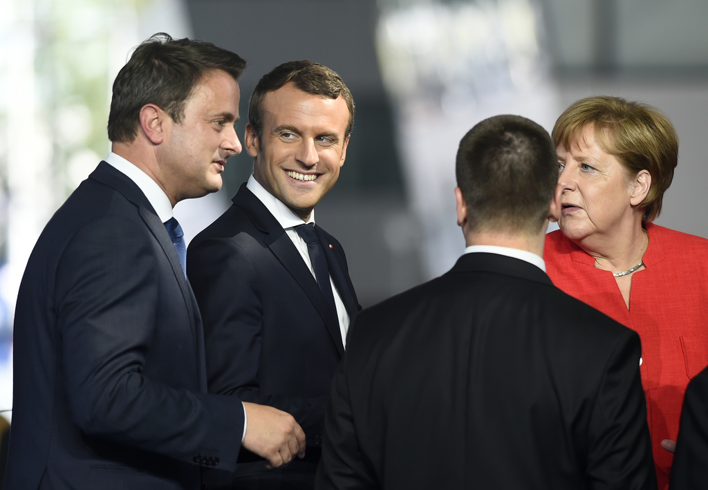 Luxembourg's Prime Minister Xavier Bettel, left, talks with French President Emmanuel Macron, second left, and German Chancellor Angela...