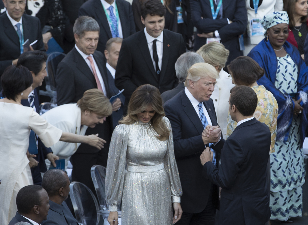 President Donald Trump, accompanied by first lady Melania Trump greets French President Emmanuel Macron and Brigitte Macron before a co...
