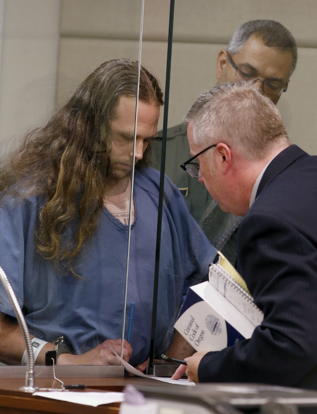 Jeremy Joseph Christian is arraigned in Multnomah County Circuit Court in Portland, Ore., Tuesday, May 30, 2017. Authorities say Christ...