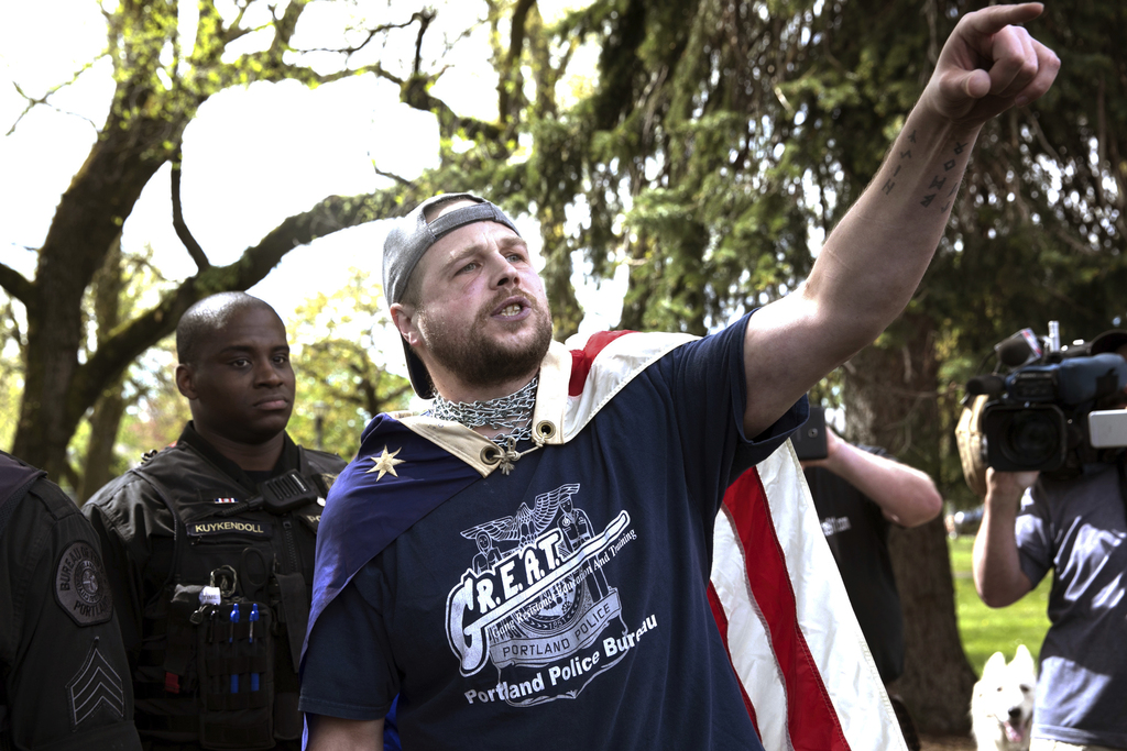 In an April 29, 2017 photo provided by John Rudoff, Jeremy Joseph Christian, right, is seen during a Patriot Prayer organized by a pro-...
