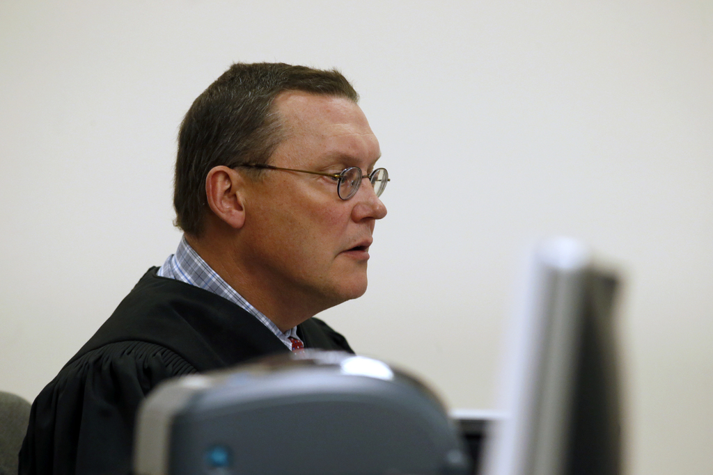 Judge Stephen Bushong listens during the arraignment of Jeremy Joseph Christian in Multnomah County Circuit Court in Portland, Ore., Tu...