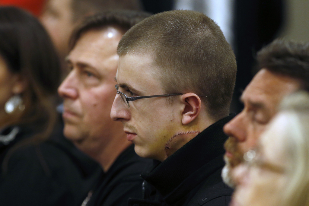 Micah Fletcher, a victim of a stabbing attack on a light rail train that left two dead, watches as suspect Jeremy Christian is arraigne...